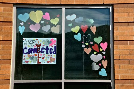 Hearts displayed o a store front window provide encouragement during the coronavirus epidemic.