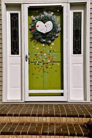 A house door is decorated with hearts