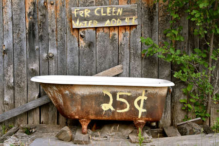 Outdoor bath with tub and water provided for only 25 cents