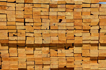 The ends of a stack of pine 2x4 studs for construction and building purposes. Stock Photo