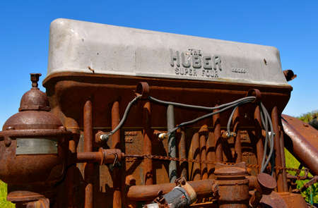 BARNESVILLE, MINNESOTA, July 21, 2021: The old rusty tractor engine is a Huber, produced from 1892-1942 by the Huber Manufacturing Company of Marion, Ohio