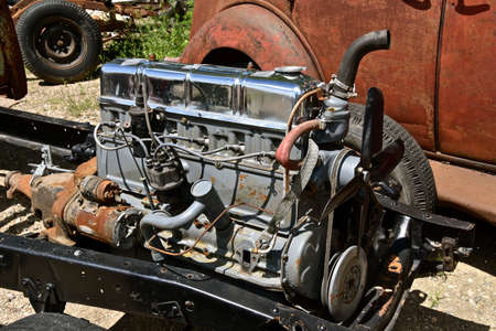 A rebuilt engine is mounted to the frame and chassis of an unknown brand of vehicle