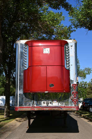 A parked refrigeration trailer on a street at a festival