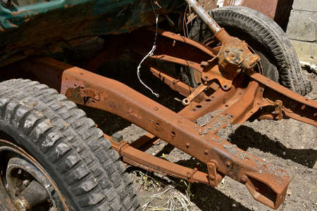The steering column and front springs are attached to the front end of an old pickup chassis