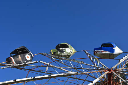 The remnants of the cars of a portable ride used at county fairs and midways in which centrifugal force provides dizziness and thrills