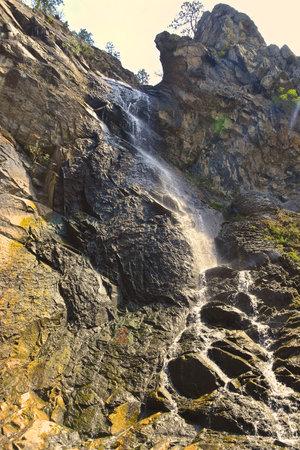 Water spraying over the rocks of a waterfalls in the Black Hills  of South Dakota. Reklamní fotografie