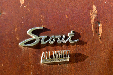 RALPH, SOUTH DAKOTA, August 15, 2020:  The rusty Scout All Wheel logo is a product of International Harvester Scout,  an off-road vehicle produced by International Harvester from 1961 to 1980. Redakční