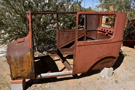 MARICOPA, ARIZONA, February 26, 2021: The Old rusty Model  T body  is a product of the Ford Motor Company located in Dearborn, Michigan started by Henry Ford and incorporated on June 16, 1903.