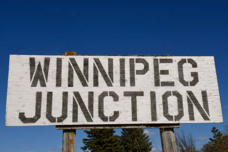 The sign WINNIPEG JUNCTION indicates the location of a Minnesota town which became a ghost town in 1909 when Northern Pacific Railroad moved the train tracks.