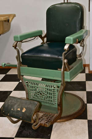 Vintage barber chair with a checkerboard floor