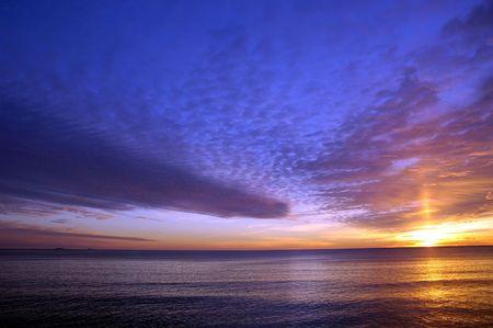 Beautiful winter sunrise over the atlantic ocean at Hampton Beach, NH photo