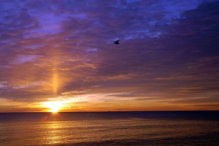 breaking free: Beautiful winter sunrise over the atlantic ocean at Hampton Beach, NH Stock Photo