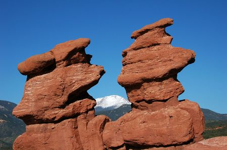 Siamese Twins rock formation naturally framing Pikes Peak in the Garden of the Gods, Colorado Springs, CO