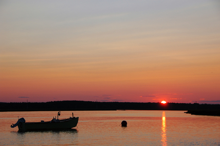 Lobster Boat anchored for the night in Taylor River in Hampton, NH