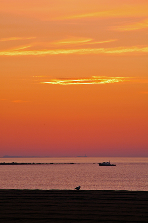 lobster boat: Summer sunrise at Hampton Beach with Lobster Boat on Boars Head