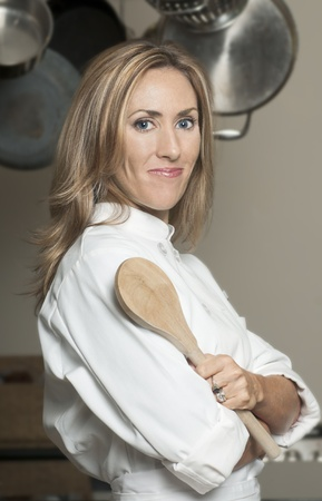 Blond woman in chef Stockfoto