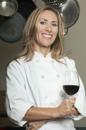 Blond woman in chef photo
