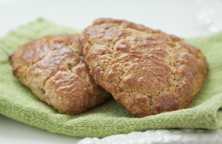 Freshly baked golden scone wedges on a platter