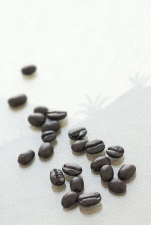 Espresso beans on glass ready for grinding Reklamní fotografie