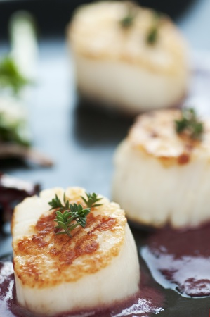 balsamic vinegar: Perfectly seared scallop starter with bright cranberry and balsamic vinegar reduction