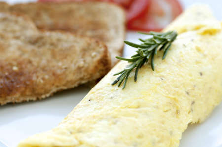 Beautiful golden rolled omelette with toast and her garnish Stockfoto