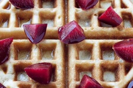 Golden round waffle with honey and fresh pluots photo