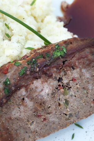 Slice of homemade meat loaf with mashed potatoes and wine sauce Stock Photo - 15038978