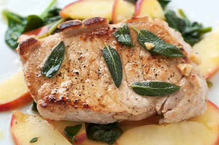 Golden pork chop with warm apple and green salad