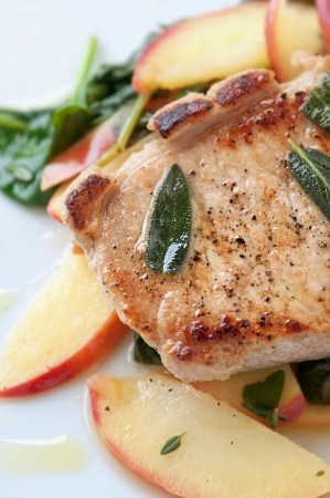 golden apple: Golden pork chop with warm apple and green salad