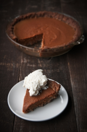 Slice of pumpkin pie with whipped cream Stock Photo - 16145688
