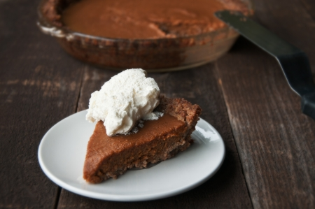 Slice of pumpkin pie with whipped cream photo