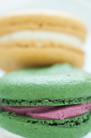 Colorful freshly baked macaroons with cream filling