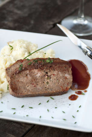 Slice of homemade meat loaf with mashed potatoes and wine sauce Stock Photo - 17654763