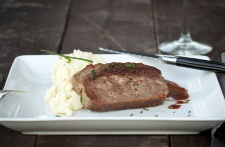 Slice of homemade meat loaf with mashed potatoes and wine sauce Stock Photo - 17654700