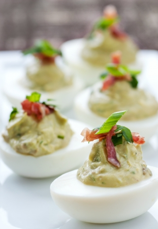 garnish: Fancy green deviled egg appetizer with garnish