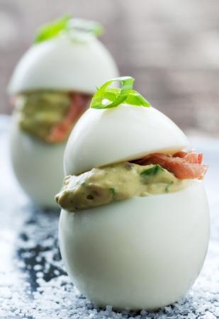 Fancy vertical deviled egg appetizer with garnish photo