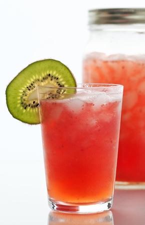 Summer cocktails blended strawberry daiquiri with kiwi garnish Reklamní fotografie