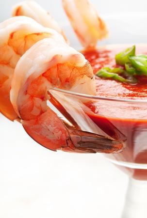 shrimp cocktail: Fresh shrimp around martini glass with cocktail sauce Stock Photo