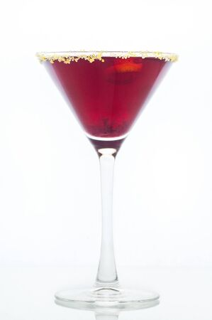 Purple mixed drink in martini glass with lemon sugar rim photo