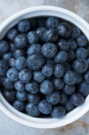 Bowl of beautiful fresh ripe plump blueberries
