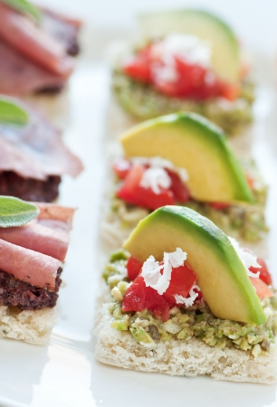 Bite size appetizers with green olive tapenade