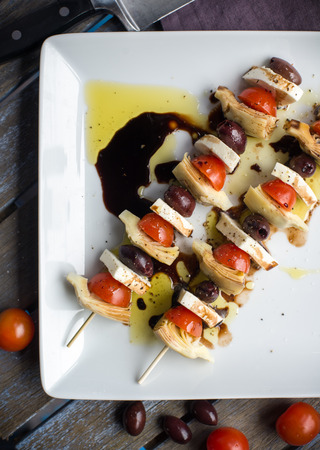 kebob: Vegetarian antipasto kepbobs drizzled with olive oil and balsamic vinegar Stock Photo