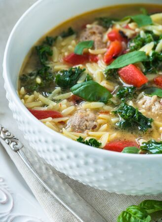 Traditional Italian soup with spicy meatballs chicken broth and orzo Reklamní fotografie