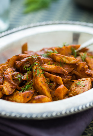 Red curried sauce chicken and parsnips with fresh dill