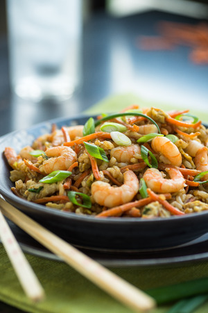 chinese food: Chinese shrimp chop suey with egg and brown rice Stock Photo