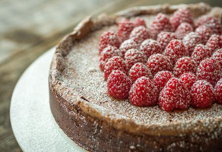 torte: Beautiful flourless chocolate torte with raspberries and powdered sugar