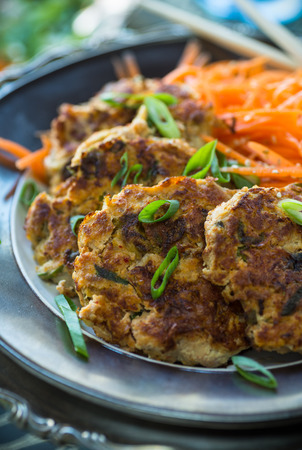 and savory: Deliciou savory kimchi cakes with Asian carrot slaw Stock Photo