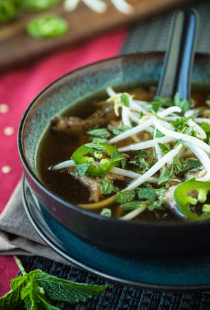 bean sprouts: Vietnamese beef Pho soup with jalapeno mint and bean sprouts Stock Photo
