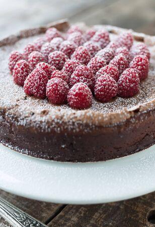 powdered sugar: Beautiful flourless chocolate torte with raspberries and powdered sugar