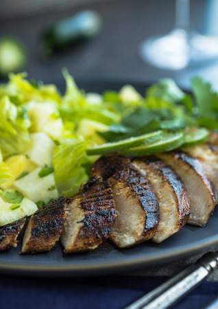 fruit salad: Spciy jerk chicken with lime and green salad with cilantro
